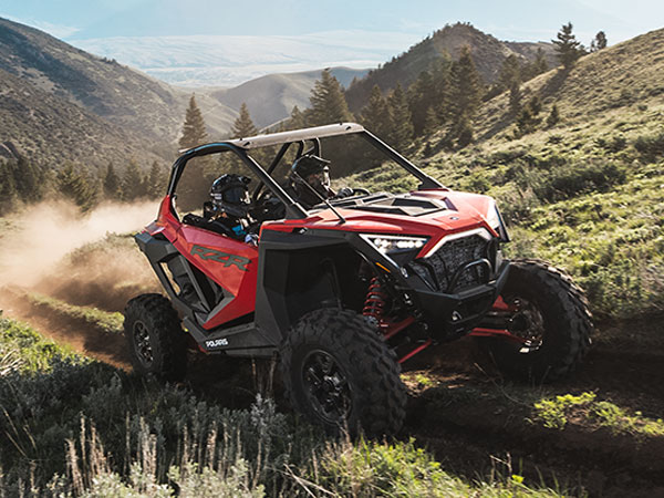 RZR driving on trail